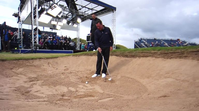 Rich Beem had a torrid time trying to demonstrate how to hit out of a bunker at the Open Zone!