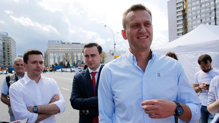 Russian opposition leader Alexei Navalny (R) and politician Ilya Yashin (L) attend a rally to support opposition and independent candidates after authorities refused to register them for September elections to the Moscow City Duma, Moscow, July 20, 2019. (Photo by Maxim ZMEYEV / AFP) (Photo credit should read MAXIM ZMEYEV/AFP/Getty Images)