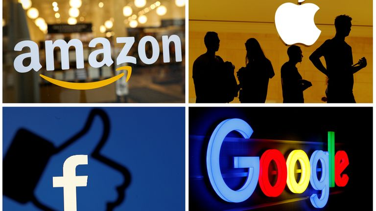 FILE PHOTO: The logos of Amazon Apple Facebook and Google
