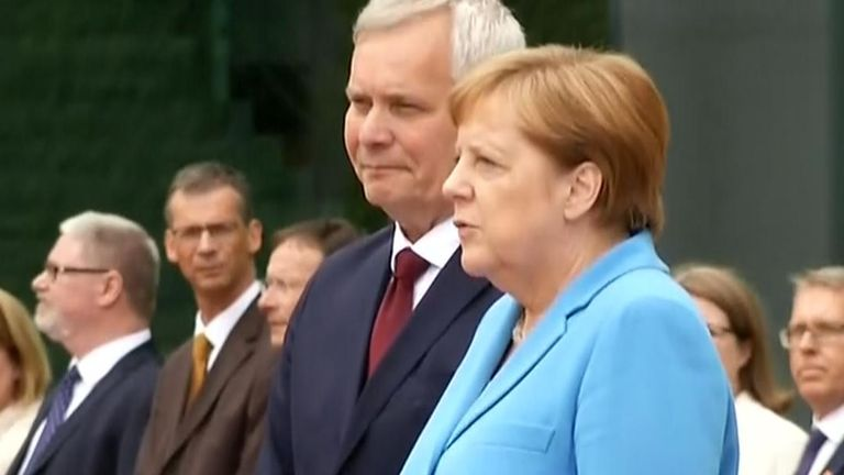 Angela Merkel visibly shaking during German National Anthem