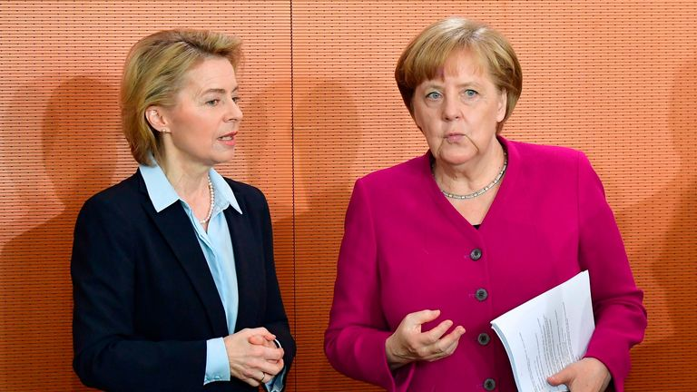 German Chancellor Angela Merkel (R) chats with Defence Minister Ursula von der Leyen prior to the weekly cabinet meeting in Berlin on May 02, 2018. (Photo by Tobias SCHWARZ / AFP)        (Photo credit should read TOBIAS SCHWARZ/AFP/Getty Images)