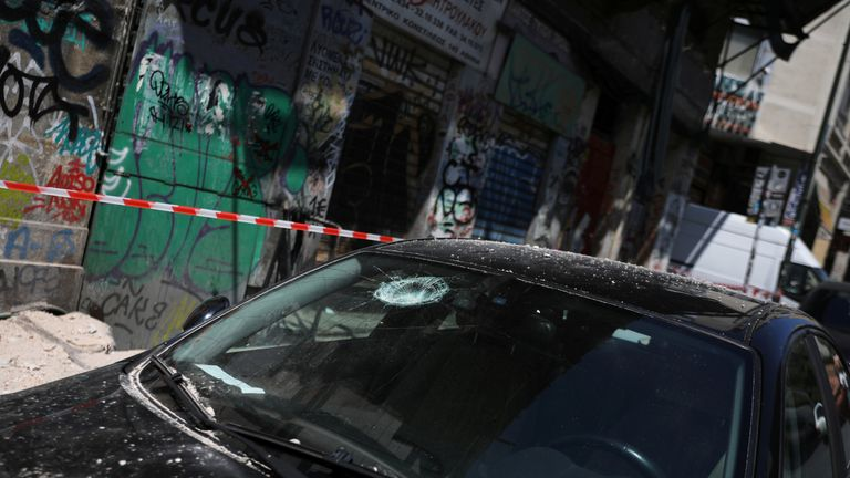 A car with a damaged windshield on a street following an earthquake in Athens, Greece