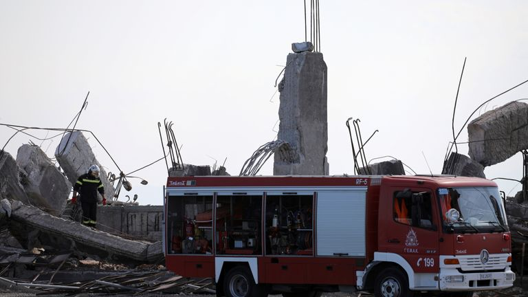 A firefighter searches for trapped people following an earthquake at the port of Piraeus, near Athens, Greece