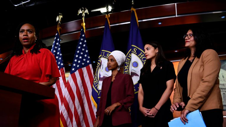 Representatives Ayanna Pressley speaks as, Ilhan Omar, Rashida Tlaib and Alexandria Ocasio-Cortez look on