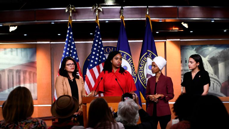 """US Representatives Ayanna Pressley (D-MA) speaks as, Ilhan Omar (D-MN)(2R), Rashida Tlaib (D-MI) (R), and Alexandria Ocasio-Cortez (D-NY) look on during a press conference, to address remarks made by US President Donald Trump earlier in the day, at the US Capitol in Washington, DC on July 15, 2019. - President Donald Trump stepped up his attacks on four progressive Democratic congresswomen, saying if they're not happy in the United States """"they can leave."""" (Photo by Brendan Smialowski / AFP) (Ph"""
