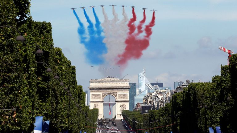 Alpha jets from the French Air Force Patrouille de France fly over the Champs-Elysees avenue during the traditional Bastille Day military parade in Paris, France, July 14, 2017