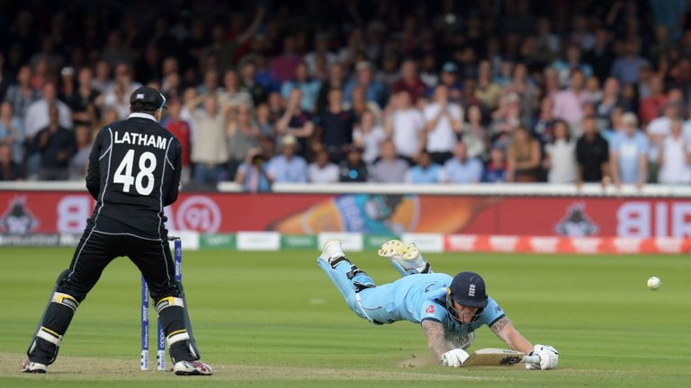 Ben Stokes dives to make his ground and the ball hits him to run away for a boundary