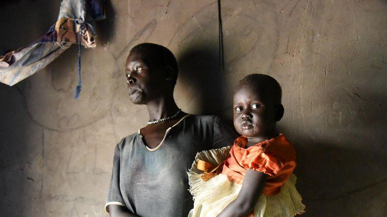 Biec Laat holding her two-month-old son Sebit Pic: UNICEF/UN0261070/Ryen