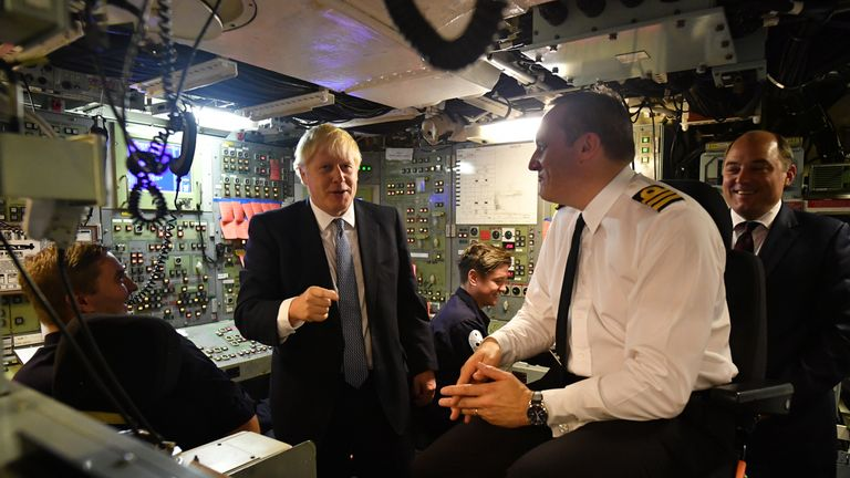 Britain's Prime Minister Boris Johnson (R) aboard Vanguard-class submarine HMS Vengeance
