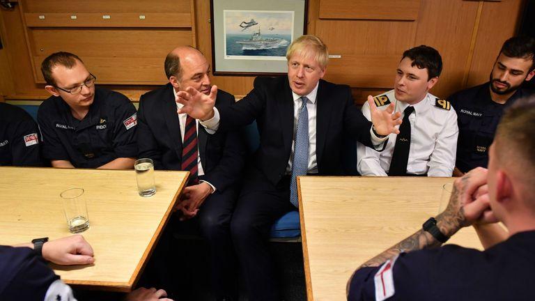 Britain's Prime Minister Boris Johnson (R) aboard Vanguard-class submarine HMS Vengeance