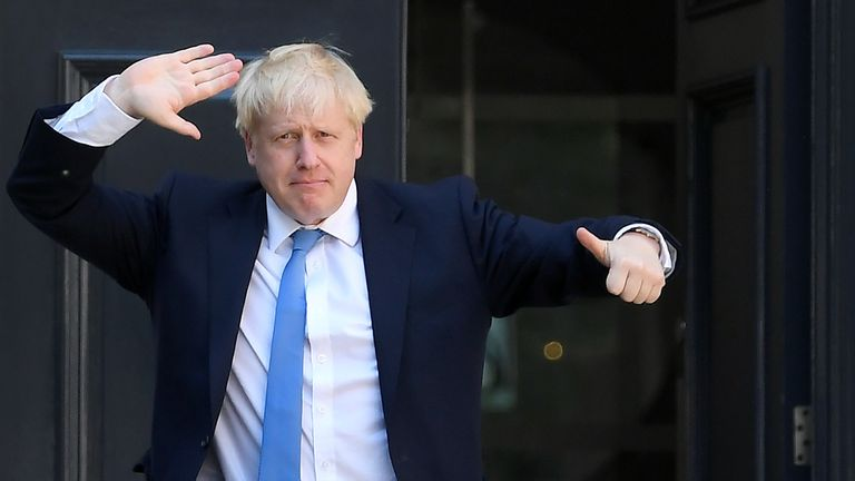 Boris Johnson gestures as he arrives at the Conservative Party headquarters, after being announced as Britain's next Prime Minister