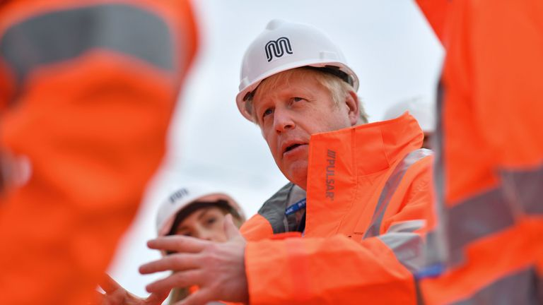Britain's Prime Minister Boris Johnson meets engineering graduates on the site of an under-construction tramline in Stretford, greater Manchester, northwest England on July 27, 2019, prior to giving a speech focusing on domestic priorities. (Photo by Ben STANSALL / various sources / AFP) (Photo credit should read BEN STANSALL/AFP/Getty Images)