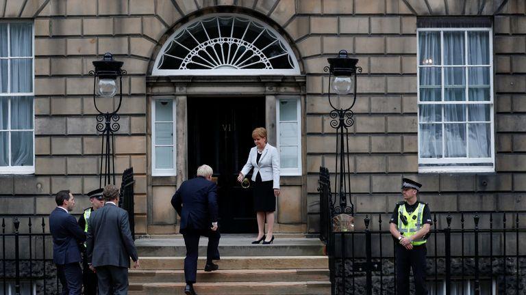 Scotland's First Minister Nicola Sturgeon welcomes Britain's Prime Minister Boris Johnson at Bute House in Edinburgh, Scotland, Britain July 29, 2019.