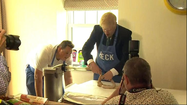 Conservative leadership candidate Boris Johnson attempts to make his own sausages in North Yorkshire.