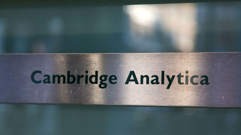 A Cambridge Analytica sign is pictured at the entrance of the building which houses the offices of Cambridge Analytica, in central London on March 21, 2018. Facebook expressed outrage over the misuse of its data as Cambridge Analytica, the British firm at the centre of a major scandal rocking the social media giant, suspended its chief executive. / AFP PHOTO / Daniel LEAL-OLIVAS (Photo credit should read DANIEL LEAL-OLIVAS/AFP/Getty Images)