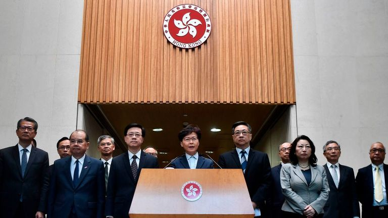 Carrie Lam (C) speaks to the media during a press conference in Hong Kong on 22 July