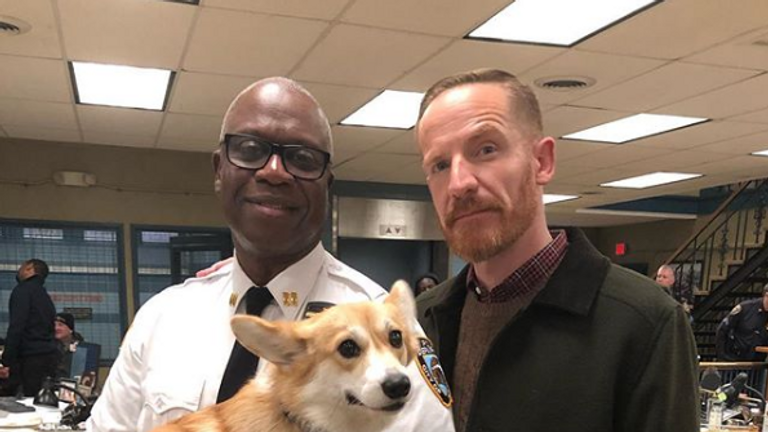 Cheddar is the dog of Captain Holt, played by Andre Braugher (left). Pic: Instagram/ Andre Braugher