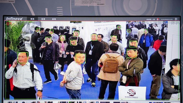 People being filmed by AI security cameras with facial recognition technology at the China International Exhibition Center