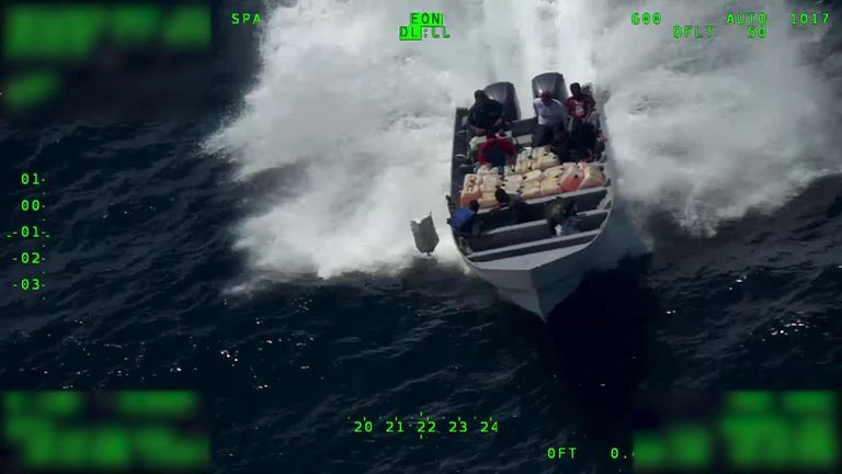 aerial footage shows suspected cocaine smugglers throwing large bags from a high-speed boat