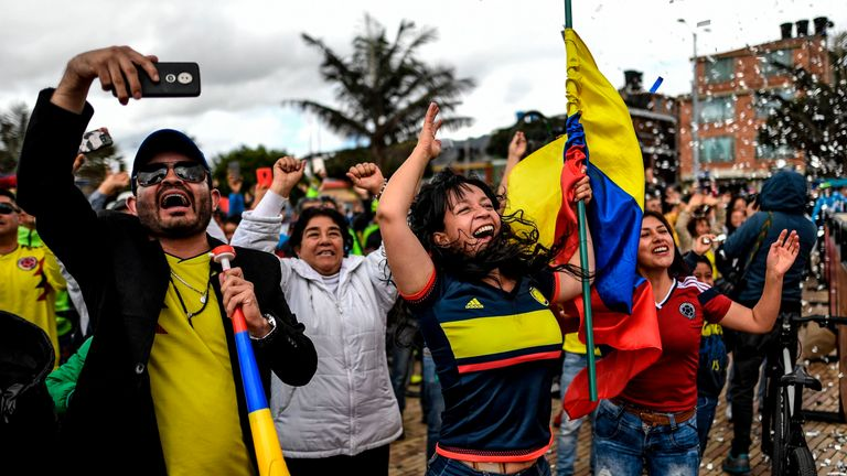 Colombians celebrate as they watch the Tour de France in Zipaquira, Cundinamarca, Colombia