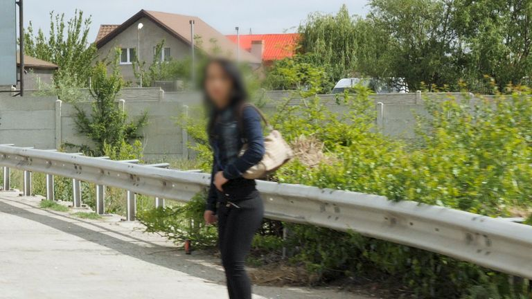 Generic shot of a young female sex worker next to the road in Craiova (note: faces intentionally blurred to protect identities)