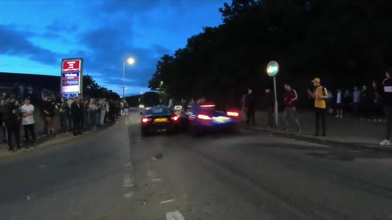 Footage shows the cars colliding before careering into bystanders