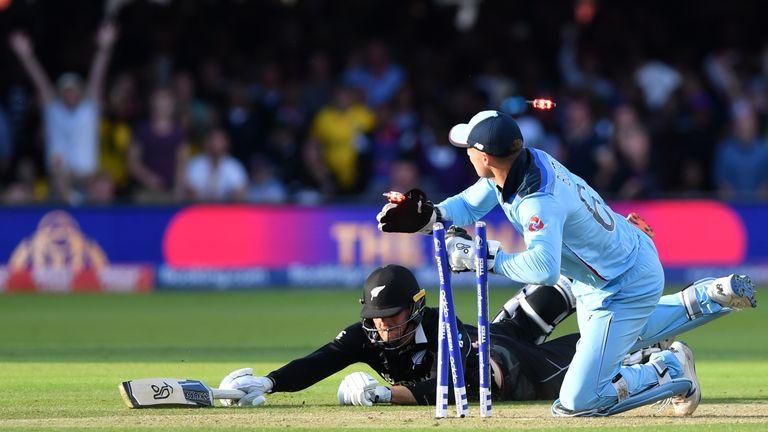 England's Jos Buttler runs out New Zealand's Martin Guptill to win the final