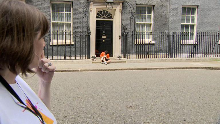 Danny, Jess Phillip's son, studies on the doorstep