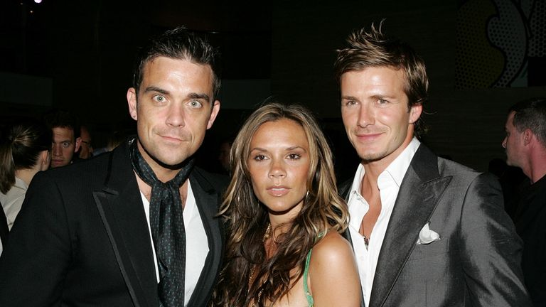 "Robbie Williams, Victoria Beckham and David Beckham pose at ""The David Beckham Academy"" launch party at Creative Artists Agency on June 3, 2005 in Beverly Hills, California"