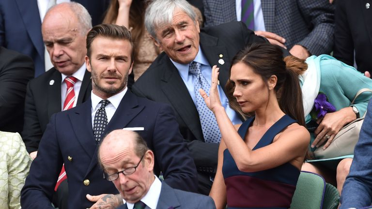David Beckham and Victoria Beckham attend the men's singles final between Novak Djokovic and Roger Federer on centre court during day thirteen of the Wimbledon Championships at Wimbledon on July 6, 2014 in London