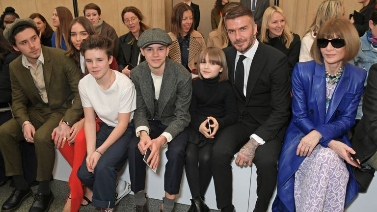 Brooklyn Beckham, Hana Cross, Cruz Beckham, Romeo Beckham, Harper Beckham, David Beckham and Dame Anna Wintour attend the Victoria Beckham show during London Fashion Week February 2019 at Tate Britain on February 17, 2019