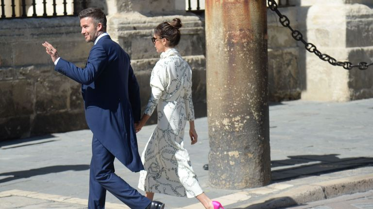 Former Real Madrid midfielder David Beckham and his wife Victoria Beckham arrive at the Cathedral of Seville on June 15, 2019 to attend the wedding ceremony of Real Madrid's Spanish football player Sergio Ramos and Pilar Rubio