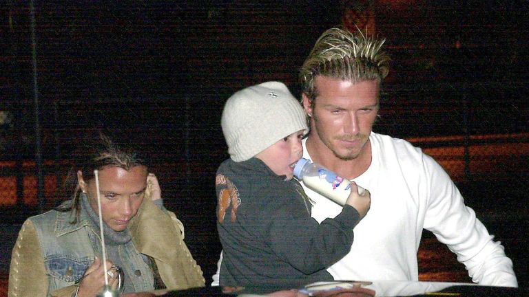 DAVID AND VICTORIA BECKHAM AT GATWICK AIRPORT, BRITAIN - 2002