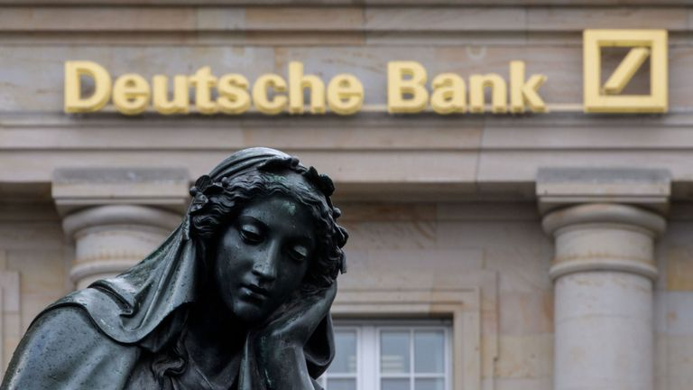 FRANKFURT AM MAIN, GERMANY - FEBRUARY 01: A branch of the German bank Deutsche Bank pictured with a sculpture of the 'Gutenberg' monument on February 1, 2018 in Frankfurt, Germany. Deutsche Bank will announce financial results for 2017 tomorrow. CEO John Cryan has reportedly said the bank had its third straight year of losses but that it will continue on the restructuring course he is leading. (Photo by Thomas Lohnes/Getty Images)