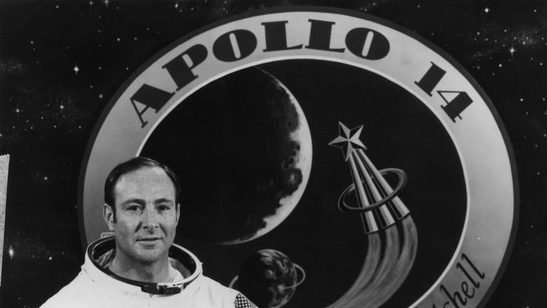November 1970: Apollo 14 Lunar Module Pilot Edgar Mitchell with the Apollo 14 emblem. (Photo by NASA/Keystone/Getty Images)