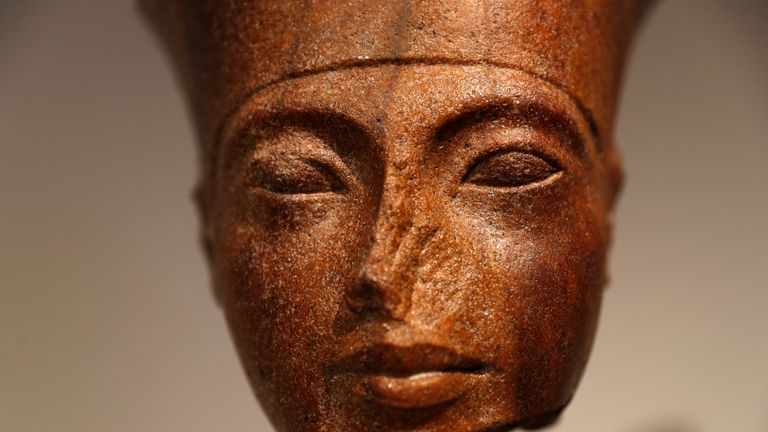 An Egyptian brown quartzite head of Tutankhamen is seen at Christie's auction house prior to its' sale in London on Thursday