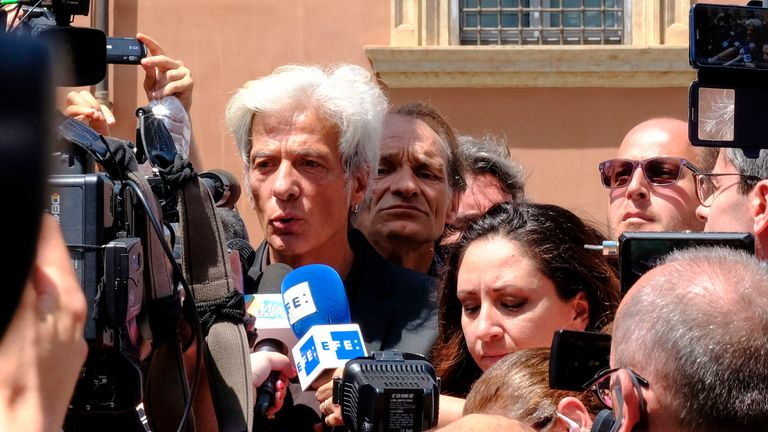 Reporters gather around Pietro Orlandi (L), the brother or Emanuela Orlandi, a teenager who disappeared in 1983 in one of Italy's darkest mysteries