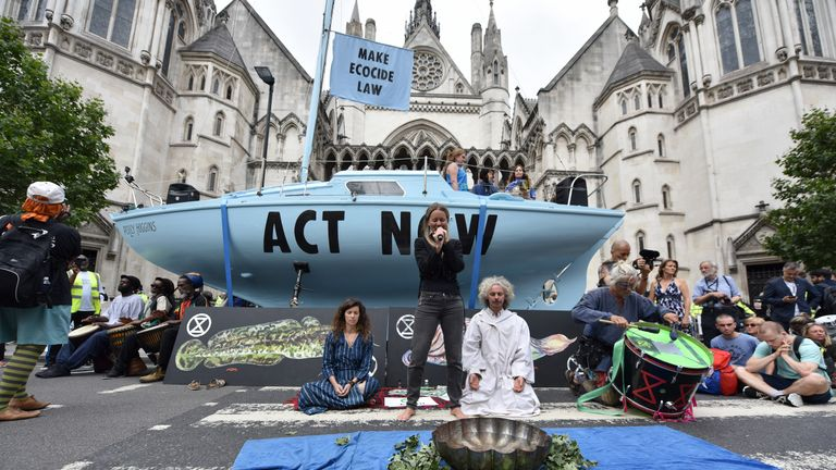 Extinction Rebellion protesters in London perform a water ceremony as they begin a series of planned week-long protests