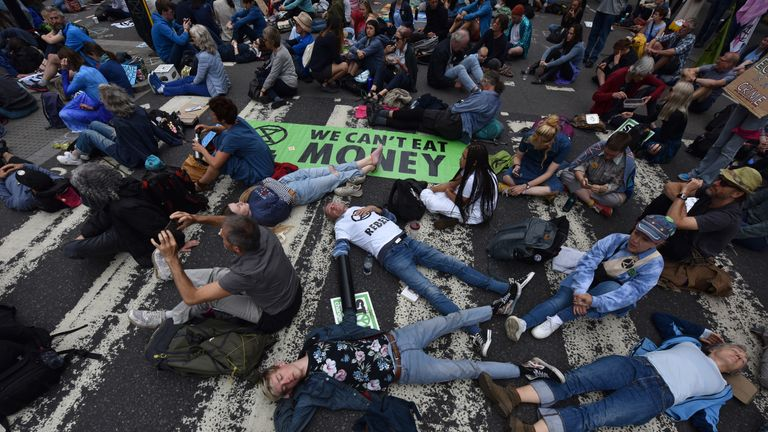 Protesters lock themselves together and block traffic on the Strand in London