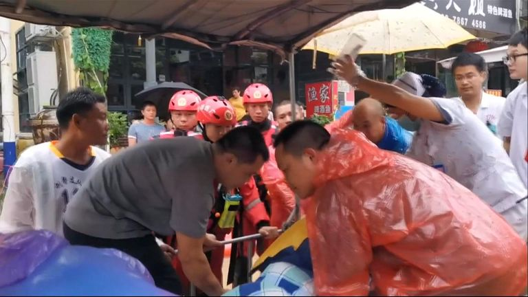 Rescuers transfer a patient in China