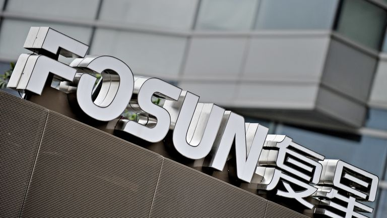 The logo of Fosun Group is seen in front of the company's headquarters building in Shanghai on June 15, 2010