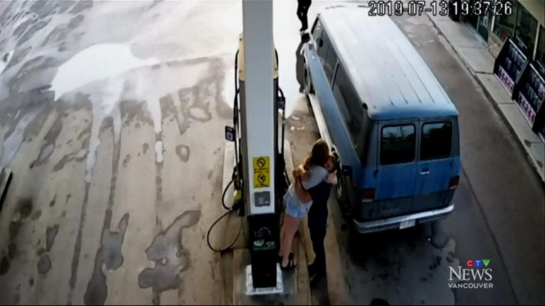 The couple hug before Deese enters the petrol station. Pic: CTV