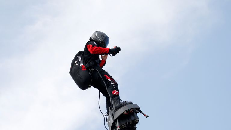 French inventor Franky Zapata lands on a Flyboard during a demonstration as he prepares to cross the English channel from Sangatte in France to Dover