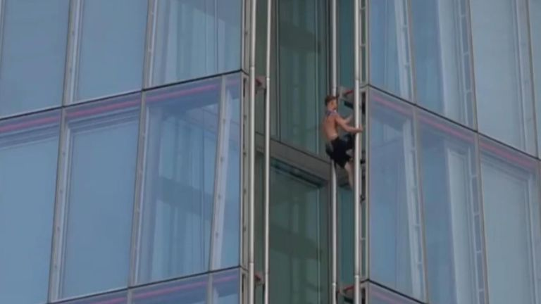 Commuters got a bit of a surprisewhen a man was spotted climbing The Shard.