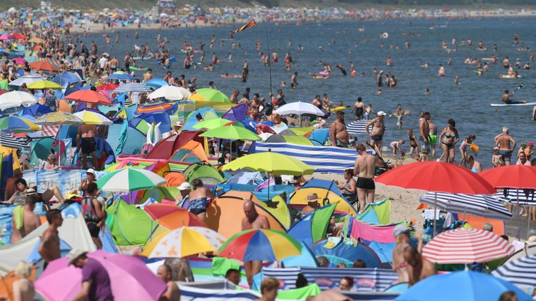 People crowd the beach at Zinnowitz on the island of Usedom in the Baltic Sea, northern Germany where temperatures reached 34 degrees Celsius