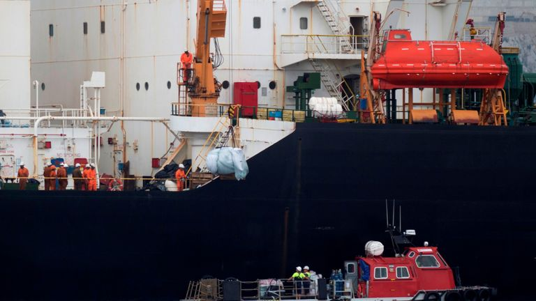 Crew members are pictured on the oil supertanker after it was seized off the coast of Gibraltar