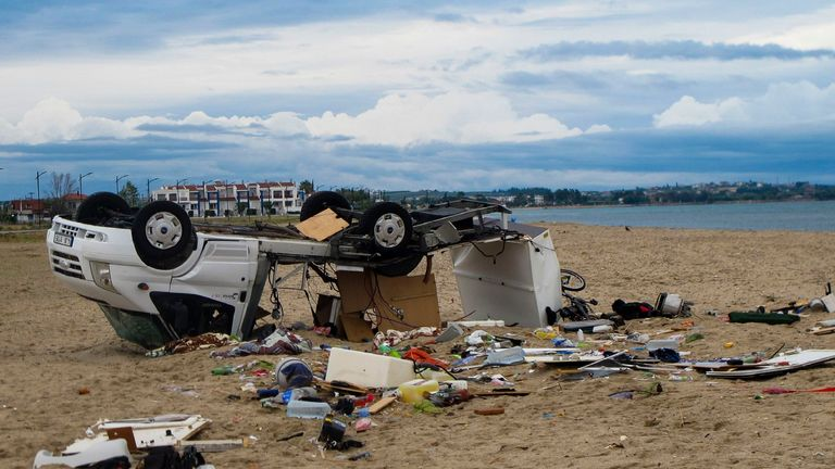 An overturned vehicle on a beach at Sozopoli village in Halkidiki region, northern Greece