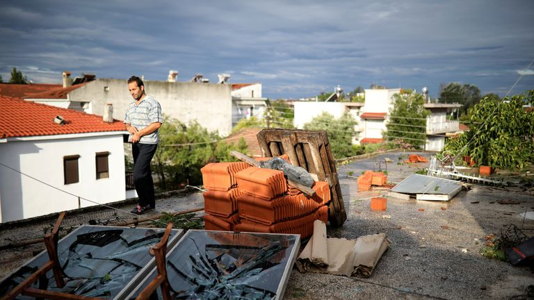 A man walks on a damaged terrace following heavy storms at the village of Nea Plagia, Greece, July 11, 2019. REUTERS/Alkis Konstantinidis