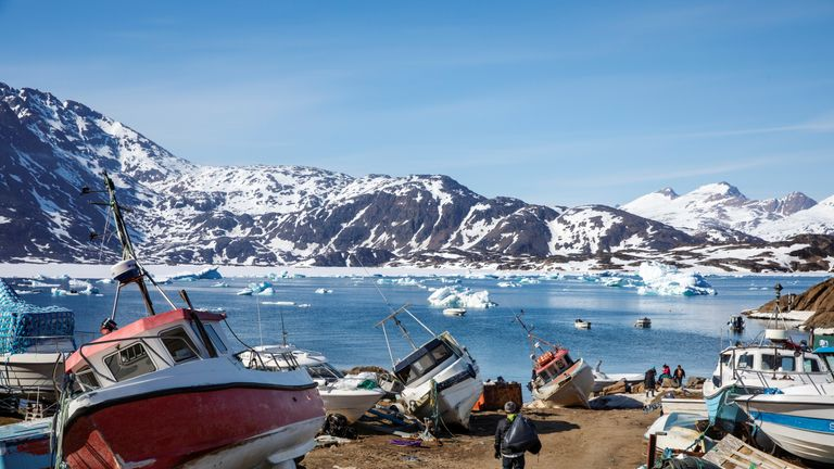 "A man walks to his boat past a number of abandoned and dry-docked boats in the town of Tasiilaq, Greenland, June 15, 2018. REUTERS/Lucas Jackson SEARCH ""JACKSON TASIILAQ"" FOR THIS STORY. SEARCH ""WIDER IMAGE"" FOR ALL STORIES."