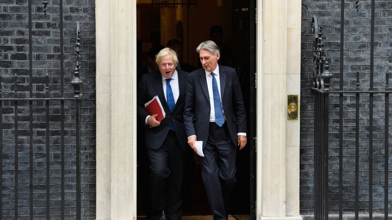 Philip Hammond (R) is striding out of cabinet before Boris Johnson can sack him